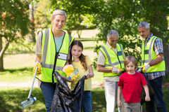 Happy family collecting rubbish Royalty Free Stock Photo
