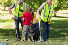 Happy family collecting rubbish Royalty Free Stock Photos