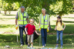 Happy family collecting rubbish. On a sunny day Royalty Free Stock Images