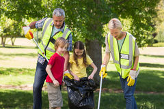 Happy family collecting rubbish Royalty Free Stock Images