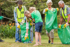 Happy family collecting rubbish Stock Image