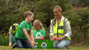 Happy family collecting rubbish stock footage
