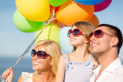 Happy family with colorful balloons outdoors Royalty Free Stock Photo