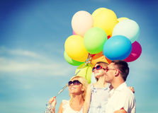 Happy family with colorful balloons outdoors Stock Photography