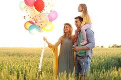 Happy family with balloons outdoors on sunny day. Happy family with colorful balloons outdoors on sunny day Stock Image