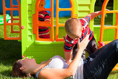 Happy family and colorful playhouse Royalty Free Stock Images
