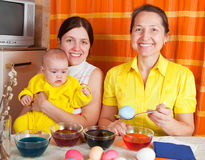 Happy family coloring easter eggs Royalty Free Stock Photos