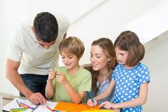 Happy family coloring at home Royalty Free Stock Photography