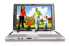 Happy family coming out laptop Royalty Free Stock Photography