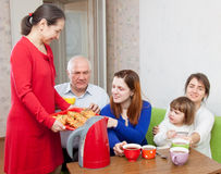 Happy  family communicate over tea Royalty Free Stock Images