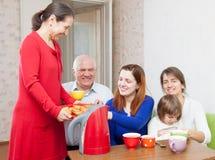 Happy  family communicate over tea Stock Image