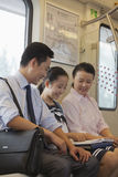 Happy family commuting together and sitting in the subway Royalty Free Stock Photography