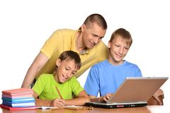 Happy family on the computer. Royalty Free Stock Photos