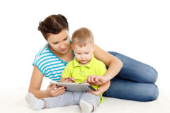 Happy family with computer tablet. Royalty Free Stock Photo