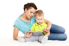 Happy family with computer tablet. Stock Photos