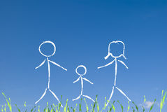 Happy family concept. An happy family concept on green meadow and blue sky Royalty Free Stock Image