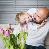 Happy family concept, father and daughter portrait. Sitting on a couch having fun stock image