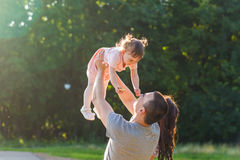 Happy family concept - father, mother and child daughter having fun and playing in nature. Royalty Free Stock Images