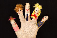 Happy family concept. On glove's fingers royalty free stock photography