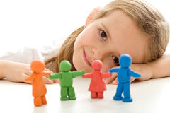 Happy family concept with little girl. And her colorful clay people - closeup stock images