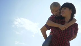 Happy family concept. mom and son cuddle cheerful carefree happy smiling. happy family lifestyle little boy rides an. Happy family concept. mom and son cuddle stock video footage