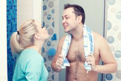Happy family after shower in the morning. Happy family concept. Portrait of a happy young couple in the modern bathroom. Indoor shot Royalty Free Stock Photography