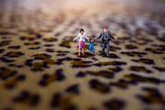 Happy Family Concept. present by Miniature Figure of Father, Mot royalty free stock photos