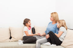 Happy family concept with young mother and daughters Royalty Free Stock Photography