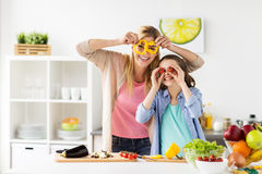 Happy family cooking dinner at home kitchen stock images