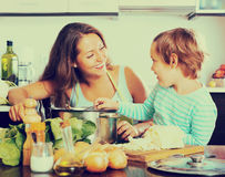 Happy family cooking food Royalty Free Stock Photos
