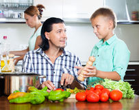Happy family cooking food Royalty Free Stock Photo