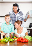Happy family cooking food together Stock Images