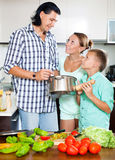 Happy family cooking food together Stock Photo