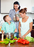 Happy family cooking food together Royalty Free Stock Image