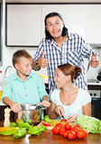 Happy family cooking food together Stock Photos