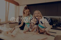 Happy Family Cooking . Girl Hold Rolling Pin. Happy Family Cooking. Little Girl Hold Rolling Pin. Happy Family Enjoy Cooking. Woman Help Girl. Grandmother Smile stock photo