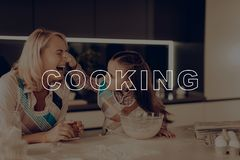 Happy Family Cooking. Girl Smeared Woman`s Nose. Happy Family Cooking. Girl Smeared Grandmother`s Nose. Happy Family Have Fan. Grandmother Help Girl. Little stock photos