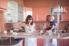 Happy family cooking at kitchen Royalty Free Stock Photography