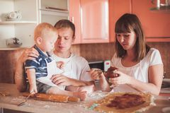 Happy family cooking at kitchen Stock Image