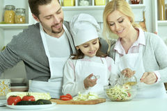 Happy family cooking  in kitchen Royalty Free Stock Image