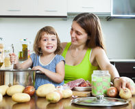 Happy family cooking soup Royalty Free Stock Images