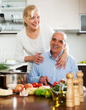 Happy family cooking soup Royalty Free Stock Image