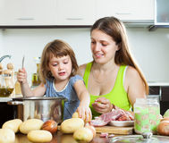 Happy family cooking soup Stock Image
