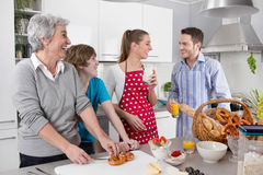 Happy family cooking together - with the grandmother. Royalty Free Stock Images