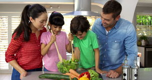 A happy family is cooking together stock footage