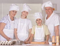 Happy family cooking together Stock Image