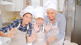 Happy family cooking together. stock video footage