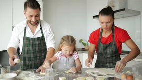 Happy Family Cooking Together. Young Daughters Are Helping To Their Parents. They Have a Lot of Fun. stock video