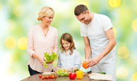 Happy family cooking vegetable salad for dinner Stock Photography