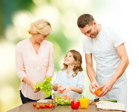 Happy family cooking vegetable salad for dinner Royalty Free Stock Image